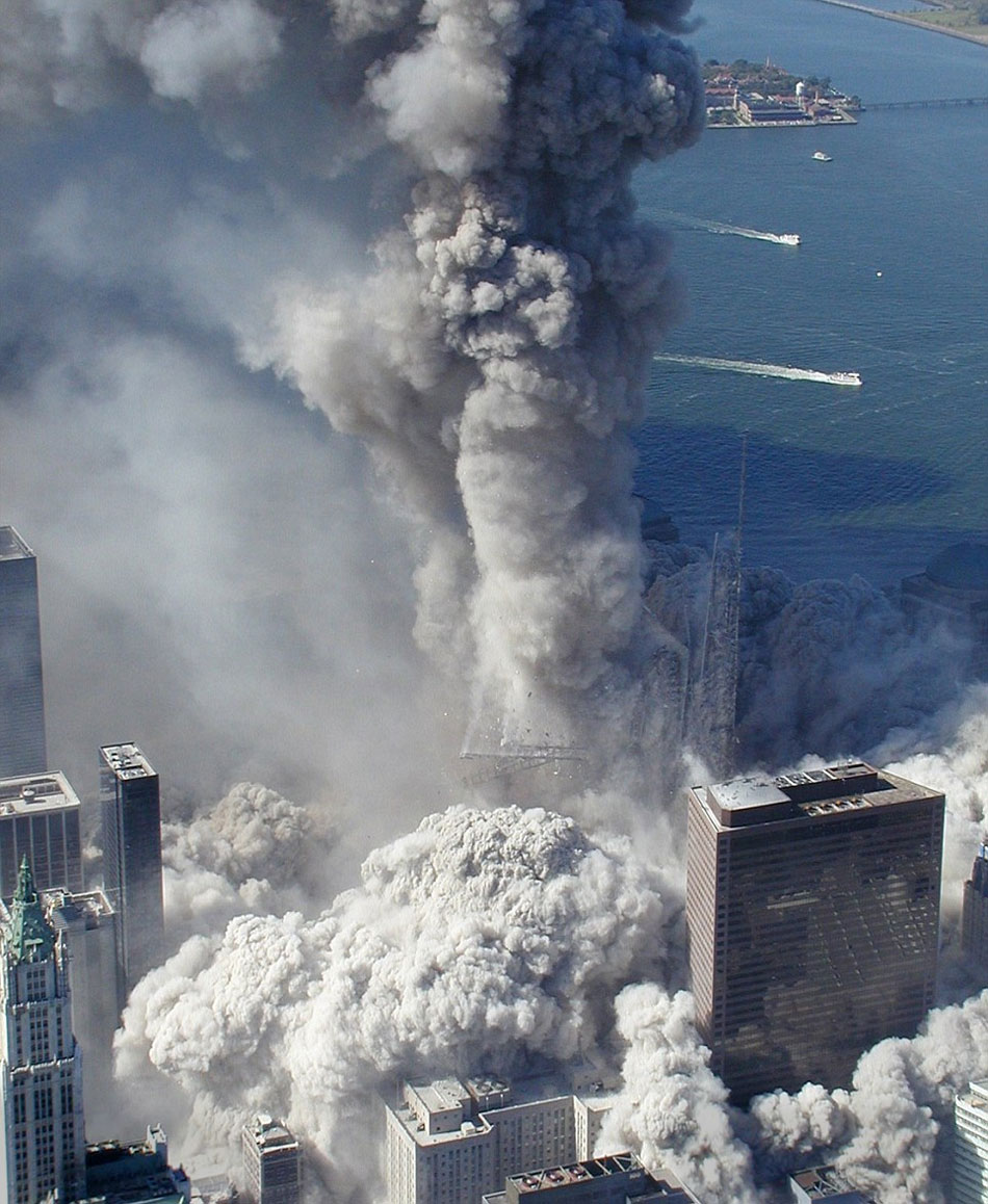 "The collapse of the North Tower of the World Trade Center in New York on September 11, 2001. Right in the foreground we see Building 7, that also collapsed like a house of cards, over six hours later. But this building wasn't attacked. According to the government report, the cause was ""a fire caused by burning debris from the WTC"
