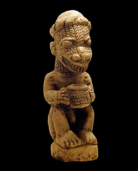 Small statue of a reptilian creature, found in the Nomoli collection