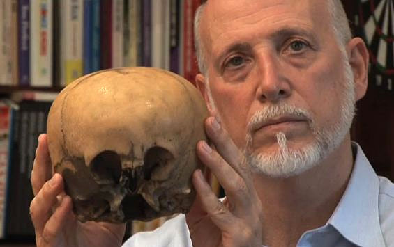 "Lloyd Pye (1946 - 2013) with his ""Starchild"" skull"
